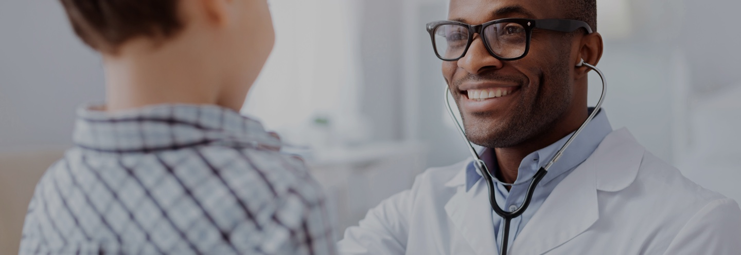 Smiling doctor with patient happy with physician disability insurance