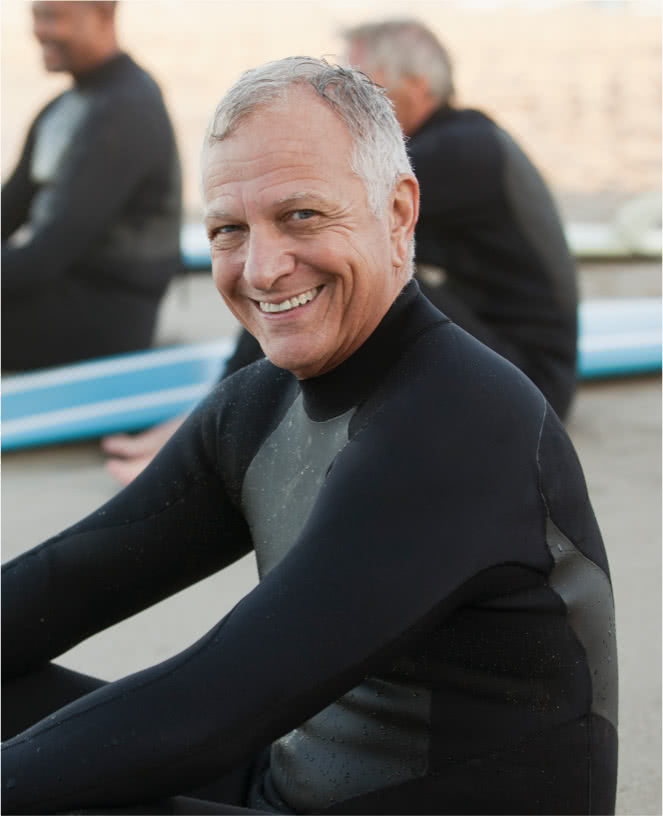 Wealth management advisor smiling in wetsuit