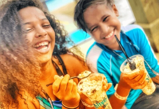 Children laughing and eating ice cream.